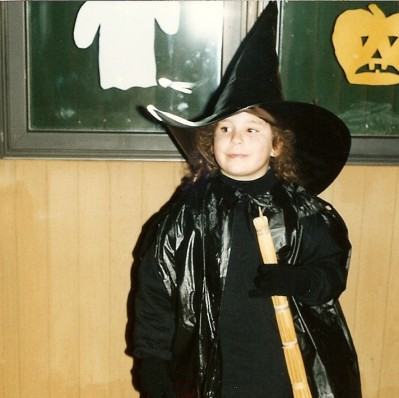Six-year-old Jess at Halloween with some of the decorations she made