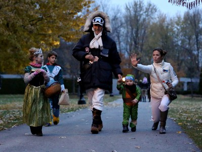 Prime Minister-designate Justin Trudeau, dressed as Han Solo from The Empire Strikes Back, walks with his children Hadrien (second from right), Ella-Grace and Xavier, as his wife Sophie Gregoire-Trudeau, dressed as Princess Leia, jokes with onlookers as the family prepares to go trick-or-treating on Halloween in Ottawa on Saturday, Oct. 31, 2015. Justin Tang/CP