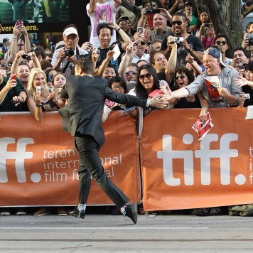 "TORONTO, ON - SEPTEMBER 10:  Joseph Gordon-Levitt runs to fans with special high fives at the ""Don Jon"" premiere during the 2013 Toronto International Film Festival held at Princess of Wales Theatre on September 10, 2013 in Toronto, Canada.  Michael Tran/Getty Images;"